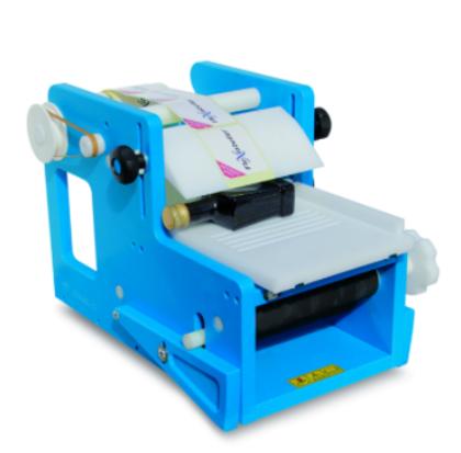 STELLIN FleXlabeller PE-Q Manuāla etiķešu līmēšanas iekārta kvadrātveida pudelēm