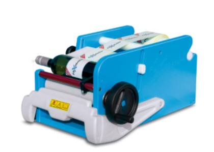 STELLIN FleXlabeller PE Manuāla etiķešu līmēšanas iekārta apaļām pudelēm